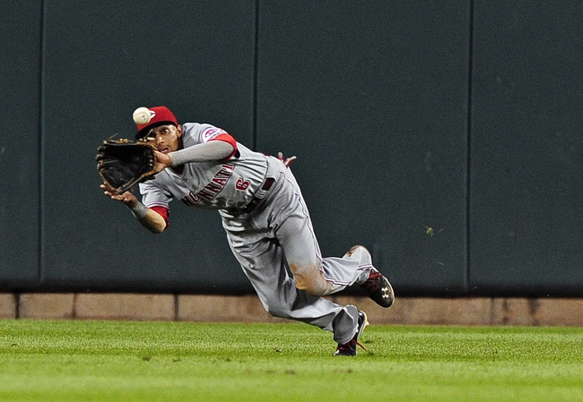 Aug 19, 2014; St. Louis, MO, USA; Cincinnati Reds center fielder Billy Hamilton (6) dives and catches a line drive hit by St. Louis Cardinals first baseman Matt Adams (not pictured) during the sixth inning at Busch Stadium. Mandatory Credit: Jeff Curry-USA TODAY Sports