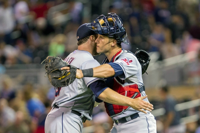 Aug 19, 2014; Minneapolis, MN, USA; Cleveland Indians relief pitcher Cody Allen (37) hugs catcher Yan Gomes (10) after their win against the Minnesota Twins at Target Field. The Cleveland Indians win 7-5. Mandatory Credit: Brad Rempel-USA TODAY Sports