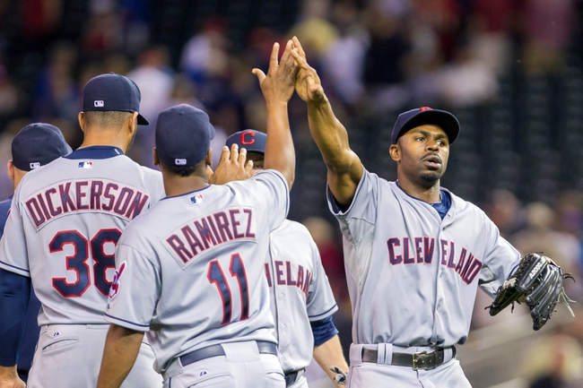 Aug 19, 2014; Minneapolis, MN, USA; Cleveland Indians center fielder Michael Bourn (24) high fives shortstop Jose Ramirez (11) after their win against the Minnesota Twins at Target Field. The Cleveland Indians win 7-5. Mandatory Credit: Brad Rempel-USA TODAY Sports