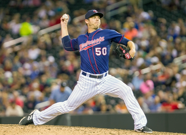 Aug 19, 2014; Minneapolis, MN, USA; Minnesota Twins relief pitcher Casey Fien (50) pitches in the eighth inning against the Cleveland Indians at Target Field. The Cleveland Indians win 7-5. Mandatory Credit: Brad Rempel-USA TODAY Sports