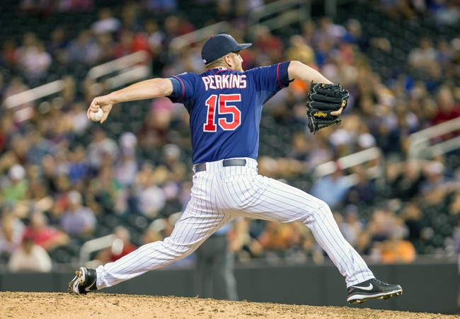 Aug 19, 2014; Minneapolis, MN, USA; Minnesota Twins relief pitcher Glen Perkins (15) pitches in the ninth inning against the Cleveland Indians at Target Field. The Cleveland Indians win 7-5. Mandatory Credit: Brad Rempel-USA TODAY Sports