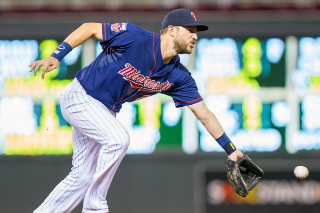 Aug 19, 2014; Minneapolis, MN, USA; Minnesota Twins third baseman Trevor Plouffe (24) fields a ground ball in the ninth inning against the Cleveland Indians at Target Field. The Cleveland Indians win 7-5. Mandatory Credit: Brad Rempel-USA TODAY Sports