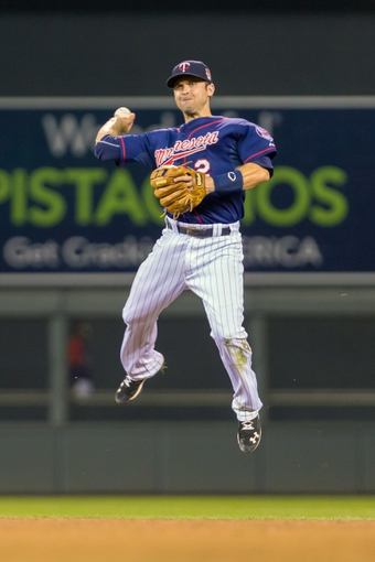 Aug 19, 2014; Minneapolis, MN, USA; Minnesota Twins second baseman Brian Dozier (2) makes a leaping throw in the sixth inning against the Cleveland Indians at Target Field. The Cleveland Indians win 7-5. Mandatory Credit: Brad Rempel-USA TODAY Sports