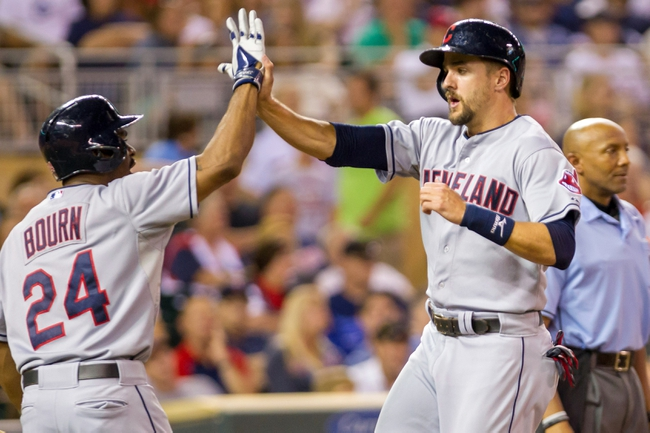 Aug 19, 2014; Minneapolis, MN, USA; Cleveland Indians third baseman Lonnie Chisenhall (8) high fives center fielder Michael Bourn (24) after scoring in the sixth inning against the Minnesota Twins at Target Field. The Cleveland Indians win 7-5. Mandatory Credit: Brad Rempel-USA TODAY Sports