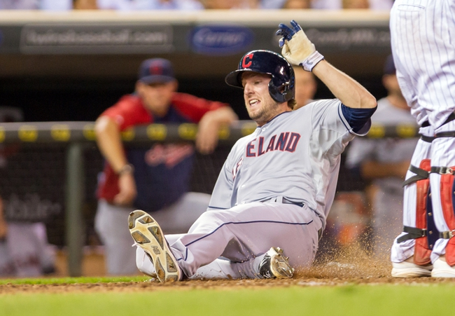 Aug 19, 2014; Minneapolis, MN, USA; Cleveland Indians right fielder Tyler Holt (62) slides home in the sixth inning against the Minnesota Twins at Target Field. The Cleveland Indians win 7-5. Mandatory Credit: Brad Rempel-USA TODAY Sports