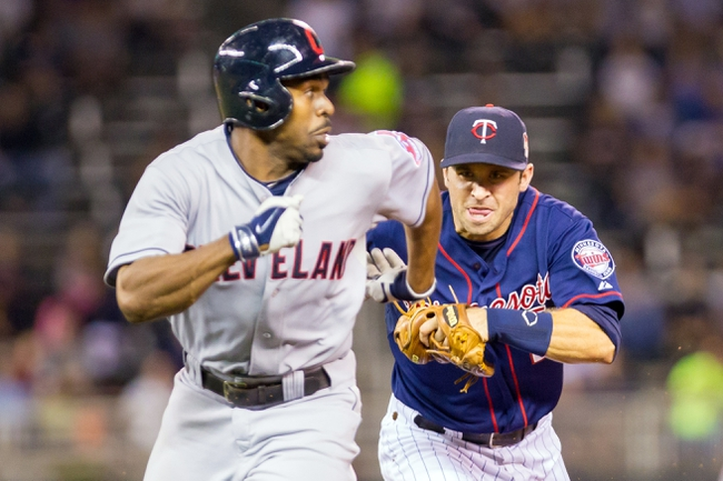 Aug 19, 2014; Minneapolis, MN, USA; Minnesota Twins second baseman Brian Dozier (2) chases Cleveland Indians center fielder Michael Bourn (24) in a rundown in the sixth inning at Target Field. The Cleveland Indians win 7-5. Mandatory Credit: Brad Rempel-USA TODAY Sports