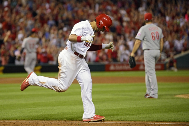 Aug 19, 2014; St. Louis, MO, USA; St. Louis Cardinals center fielder Jon Jay (19) celebrates after being hit by a pitch from Cincinnati Reds relief pitcher J.J. Hoover (60) allowing the game winning run to score during the ninth inning at Busch Stadium. The Cardinals defeated the Reds 5-4. Mandatory Credit: Jeff Curry-USA TODAY Sports