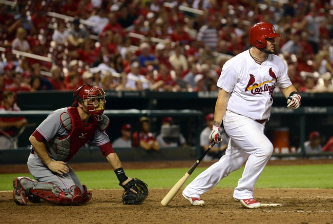 Aug 19, 2014; St. Louis, MO, USA; St. Louis Cardinals first baseman Matt Adams (32) hits a single off of Cincinnati Reds relief pitcher J.J. Hoover (not pictured) during the ninth inning at Busch Stadium. The Cardinals defeated the Reds 5-4. Mandatory Credit: Jeff Curry-USA TODAY Sports