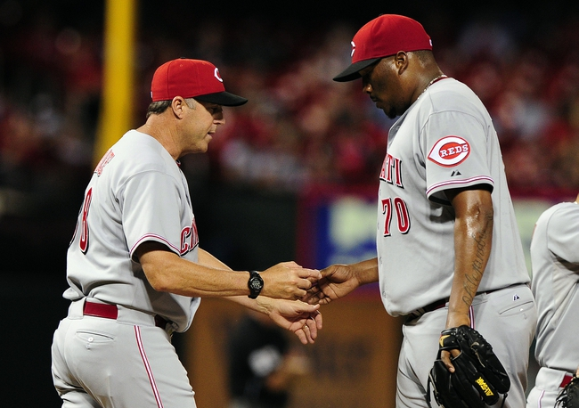 Aug 19, 2014; St. Louis, MO, USA; Cincinnati Reds manager Bryan Price (38) removes relief pitcher Jumbo Diaz (70) during the eighth inning against the St. Louis Cardinals at Busch Stadium. The Cardinals defeated the Reds 5-4. Mandatory Credit: Jeff Curry-USA TODAY Sports