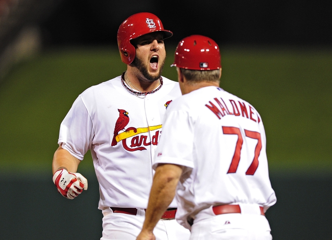 Aug 19, 2014; St. Louis, MO, USA; St. Louis Cardinals first baseman Matt Adams (32) celebrates after hitting a single during the ninth inning against the Cincinnati Reds at Busch Stadium. The Cardinals defeated the Reds 5-4. Mandatory Credit: Jeff Curry-USA TODAY Sports