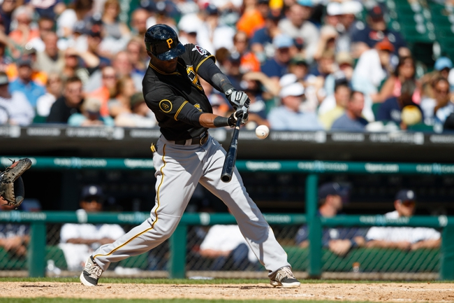 Aug 14, 2014; Detroit, MI, USA; Pittsburgh Pirates left fielder Starling Marte (6) at bat against the Detroit Tigers at Comerica Park. Mandatory Credit: Rick Osentoski-USA TODAY Sports