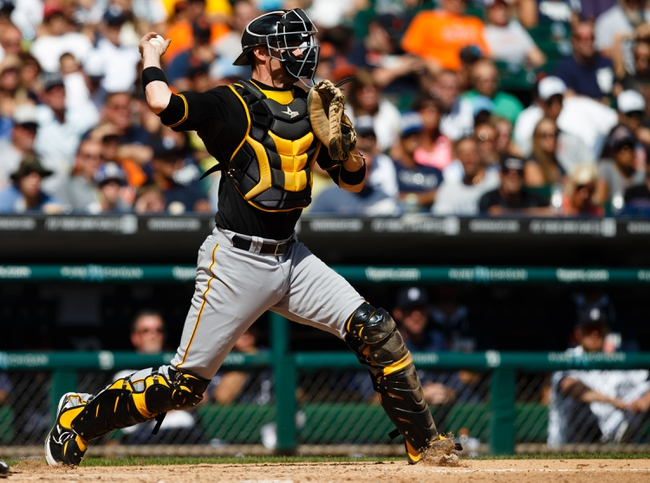 Aug 14, 2014; Detroit, MI, USA; Pittsburgh Pirates catcher Chris Stewart (19) makes a throw against the Detroit Tigers at Comerica Park. Mandatory Credit: Rick Osentoski-USA TODAY Sports