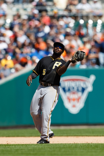 Aug 14, 2014; Detroit, MI, USA; Pittsburgh Pirates third baseman Josh Harrison (5) makes a catch against the Detroit Tigers at Comerica Park. Mandatory Credit: Rick Osentoski-USA TODAY Sports