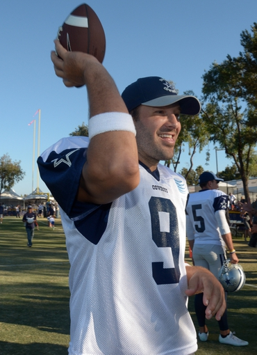 Aug 12, 2014; Oxnard, CA, USA; Dallas Cowboys quarterback Tony Romo (9) at scrimmage against the Oakland Raiders at River Ridge Fields. Mandatory Credit: Kirby Lee-USA TODAY Sports