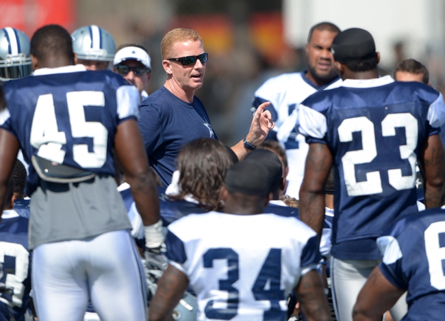 Aug 12, 2014; Oxnard, CA, USA; Dallas Cowboys coach Jason Garrett talks with players in a huddle at scrimmage against the Oakland Raiders at River Ridge Fields. Mandatory Credit: Kirby Lee-USA TODAY Sports