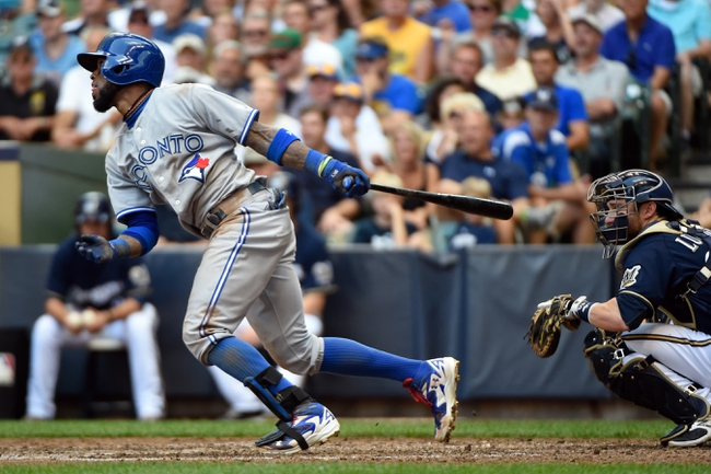 Aug 20, 2014; Milwaukee, WI, USA;  Toronto Blue Jays shortstop Jose Reyes (7) hits a base hit to drive in a run in the sixth inning against the Milwaukee Brewers at Miller Park. Mandatory Credit: Benny Sieu-USA TODAY Sports