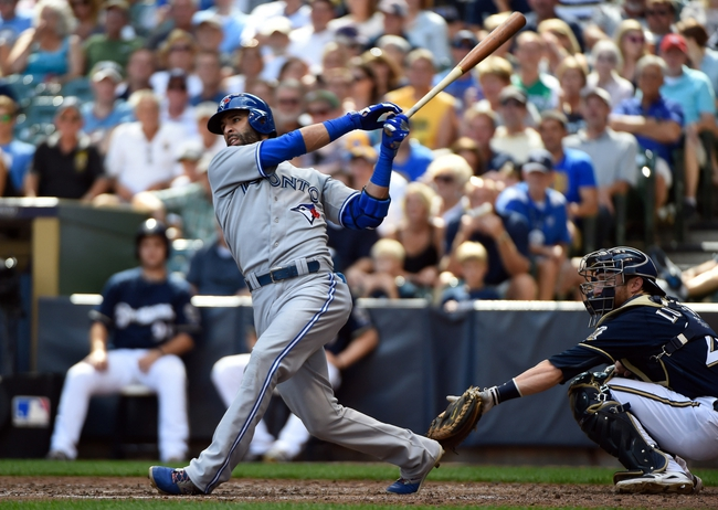 Aug 20, 2014; Milwaukee, WI, USA;  Toronto Blue Jays right fielder Jose Bautista (19) hits a 3-run home run in the sixth inning as Milwaukee Brewers catcher Jonathan Lucroy (20) watches at Miller Park. Mandatory Credit: Benny Sieu-USA TODAY Sports