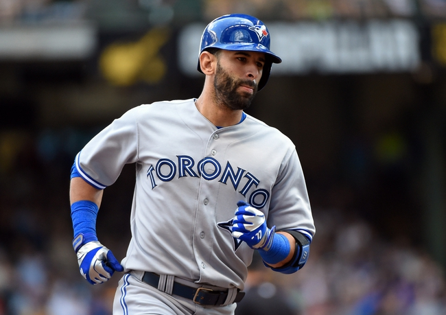 Aug 20, 2014; Milwaukee, WI, USA;  Toronto Blue Jays right fielder Jose Bautista (19) runs the bases after hitting a 3-run home run in the sixth inning against the Milwaukee Brewers at Miller Park. Mandatory Credit: Benny Sieu-USA TODAY Sports