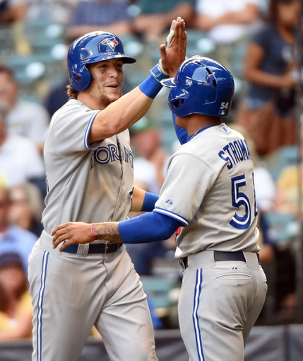 Aug 20, 2014; Milwaukee, WI, USA;  Toronto Blue Jays center fielder Colby Rasmus (28) celebrates with pinch runner Marcus Stroman (54) after hitting a 2-run home run against the Milwaukee Brewers at Miller Park. Mandatory Credit: Benny Sieu-USA TODAY Sports