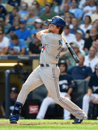 Aug 20, 2014; Milwaukee, WI, USA; Toronto Blue Jays center fielder Colby Rasmus (28) hits s 2-run home run in the ninth inning against the Milwaukee Brewers at Miller Park. Mandatory Credit: Benny Sieu-USA TODAY Sports