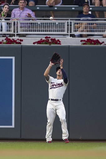 Aug 20, 2014; Minneapolis, MN, USA; Minnesota Twins left fielder Jordan Schafer (1) catches a fly ball in the second inning against the Cleveland Indians at Target Field. Mandatory Credit: Jesse Johnson-USA TODAY Sports