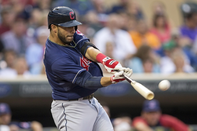 Aug 20, 2014; Minneapolis, MN, USA; Cleveland Indians third baseman Mike Aviles (4) hits a single in the second inning against the Minnesota Twins at Target Field. Mandatory Credit: Jesse Johnson-USA TODAY Sports