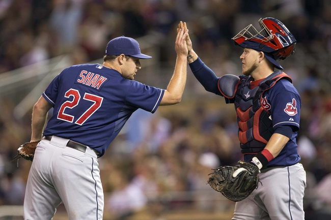 Aug 20, 2014; Minneapolis, MN, USA; Cleveland Indians relief pitcher Bryan Shaw (27) celebrates with catcher Roberto Perez (55) after betting the Minnesota Twins at Target Field. The Indians won 5-0. Mandatory Credit: Jesse Johnson-USA TODAY Sports