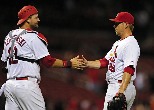 Aug 20, 2014; St. Louis, MO, USA; St. Louis Cardinals relief pitcher Trevor Rosenthal (26) celebrates with catcher A.J. Pierzynski (35) after defeating the Cincinnati Reds at Busch Stadium. The Cardinals defeated the Reds 7-3. Mandatory Credit: Jeff Curry-USA TODAY Sports