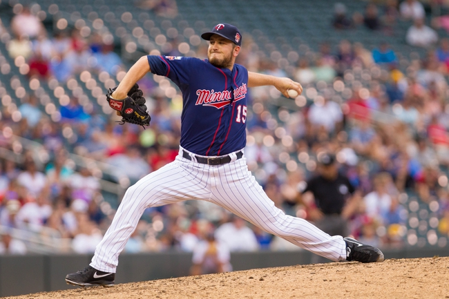 Aug 21, 2014; Minneapolis, MN, USA; Minnesota Twins relief pitcher Glen Perkins (15) pitches in the ninth inning against the Cleveland Indians at Target Field. The Minnesota Twins win 4-1. Mandatory Credit: Brad Rempel-USA TODAY Sports