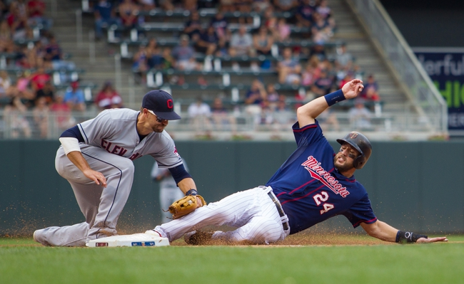Aug 21, 2014; Minneapolis, MN, USA; Minnesota Twins third baseman Trevor Plouffe (24) gets tagged out at third by Cleveland Indians third baseman Lonnie Chisenhall (8) in the sixth inning at Target Field. The Minnesota Twins win 4-1. Mandatory Credit: Brad Rempel-USA TODAY Sports
