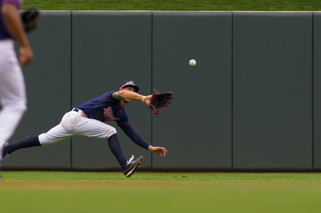 Aug 21, 2014; Minneapolis, MN, USA; Minnesota Twins center fielder Jordan Schafer (1) makes a diving catch in the sixth inning against the Cleveland Indians at Target Field. The Minnesota Twins win 4-1. Mandatory Credit: Brad Rempel-USA TODAY Sports