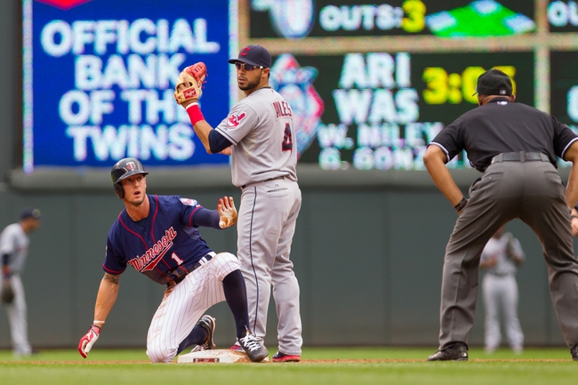 Aug 21, 2014; Minneapolis, MN, USA; Minnesota Twins center fielder Jordan Schafer (1) is safe at second in the fifth inning against the Cleveland Indians shortstop Mike Aviles (4) at Target Field. The Minnesota Twins win 4-1. Mandatory Credit: Brad Rempel-USA TODAY Sports