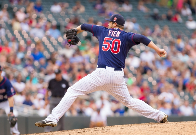 Aug 21, 2014; Minneapolis, MN, USA; Minnesota Twins relief pitcher Casey Fien (50) pitches in the eighth inning against the Cleveland Indians at Target Field. The Minnesota Twins win 4-1. Mandatory Credit: Brad Rempel-USA TODAY Sports
