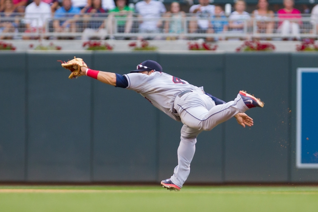 Aug 21, 2014; Minneapolis, MN, USA; Cleveland Indians shortstop Mike Aviles (4) makes a diving stop in the eighth inning against the Minnesota Twins at Target Field. The Minnesota Twins win 4-1. Mandatory Credit: Brad Rempel-USA TODAY Sports