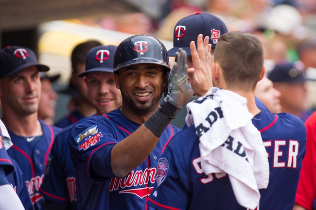 Aug 21, 2014; Minneapolis, MN, USA; Minnesota Twins shortstop Eduardo Nunez (9) high fives teammates after scoring in the eighth inning against the Cleveland Indians at Target Field. The Minnesota Twins win 4-1. Mandatory Credit: Brad Rempel-USA TODAY Sports