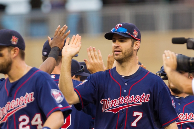 Aug 21, 2014; Minneapolis, MN, USA; Minnesota Twins first baseman Joe Mauer (7) high fives teammates after the game against the Cleveland Indians at Target Field. The Minnesota Twins win 4-1. Mandatory Credit: Brad Rempel-USA TODAY Sports