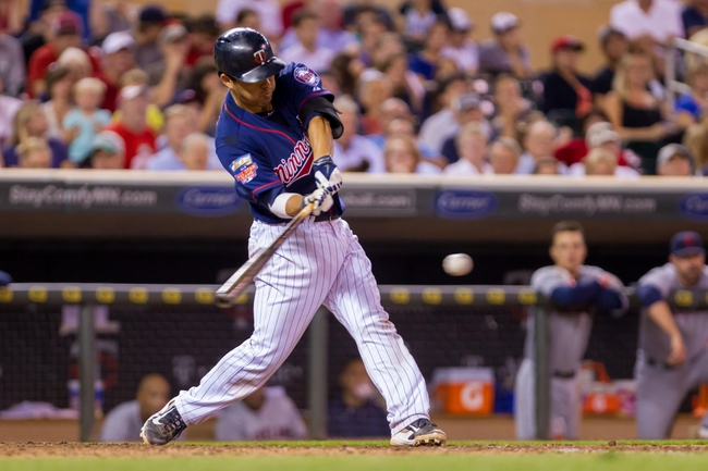 Aug 19, 2014; Minneapolis, MN, USA; Minnesota Twins catcher Kurt Suzuki (8) at bat against the Cleveland Indians at Target Field. Mandatory Credit: Brad Rempel-USA TODAY Sports