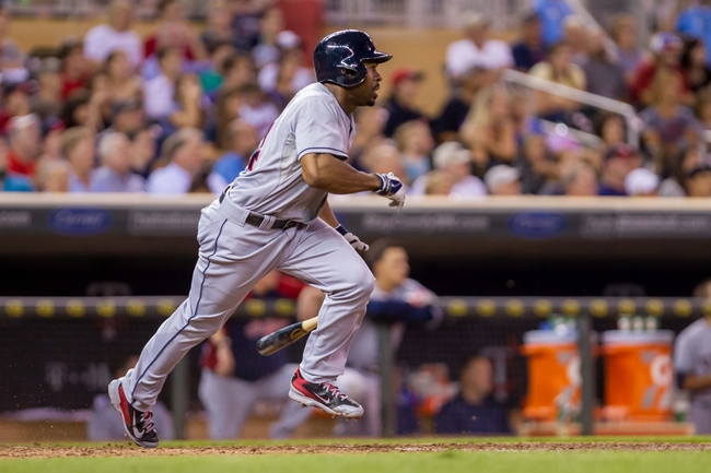 Aug 19, 2014; Minneapolis, MN, USA; Cleveland Indians center fielder Michael Bourn (24) runs to first against the Minnesota Twins at Target Field. Mandatory Credit: Brad Rempel-USA TODAY Sports