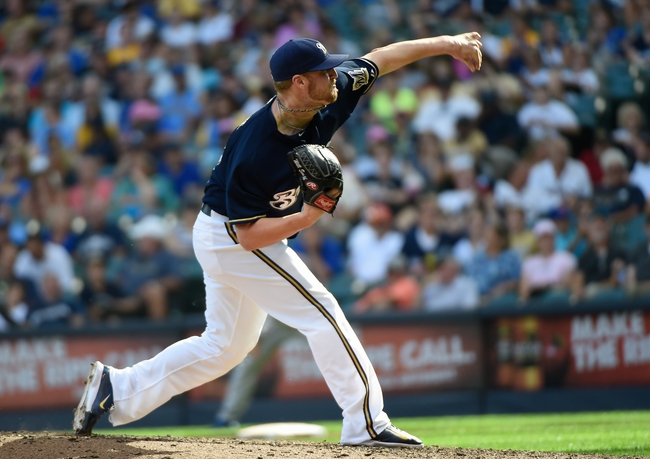 Aug 20, 2014; Milwaukee, WI, USA;  Milwaukee Brewers pitcher Will Smith (13) during the game against the Toronto Blue Jays at Miller Park. Mandatory Credit: Benny Sieu-USA TODAY Sports