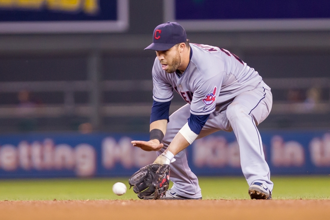 Aug 19, 2014; Minneapolis, MN, USA; Cleveland Indians second baseman Jason Kipnis (22) fields a ground ball against the Minnesota Twins at Target Field. Mandatory Credit: Brad Rempel-USA TODAY Sports