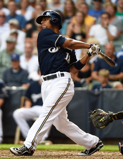 Aug 20, 2014; Milwaukee, WI, USA; Milwaukee Brewers left fielder Khris Davis (18) during the game against the Toronto Blue Jays at Miller Park. Mandatory Credit: Benny Sieu-USA TODAY Sports