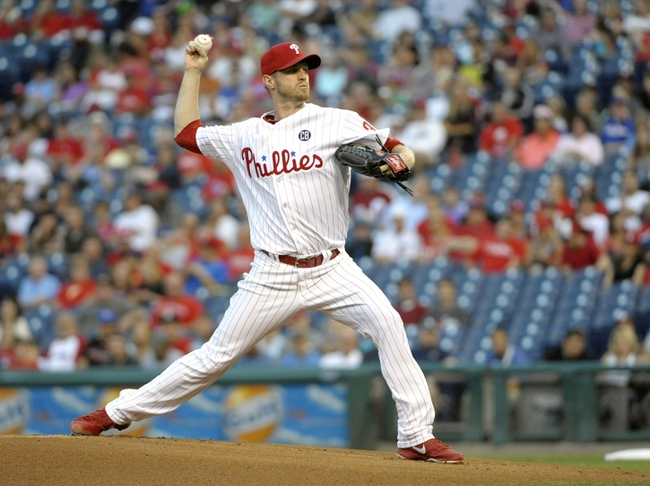 Aug 22, 2014; Philadelphia, PA, USA; Philadelphia Phillies starting pitcher Kyle Kendrick (38) throws a pitch in the first inning against the St. Louis Cardinals at Citizens Bank Park. Mandatory Credit: Eric Hartline-USA TODAY Sports