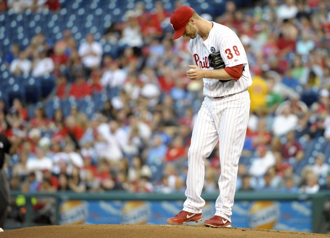 Aug 22, 2014; Philadelphia, PA, USA; Philadelphia Phillies starting pitcher Kyle Kendrick (38) reacts after allowing a 2-RBI double in the first inning against the St. Louis Cardinals at Citizens Bank Park. Mandatory Credit: Eric Hartline-USA TODAY Sports