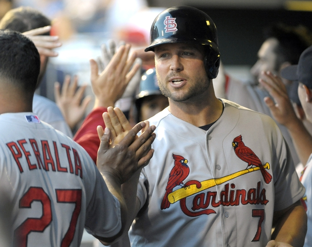 Aug 22, 2014; Philadelphia, PA, USA; St. Louis Cardinals left fielder Matt Holliday (7) gets congratulates in the dugout after hitting a  2-RBI double in the first inning against the Philadelphia Phillies at Citizens Bank Park. Mandatory Credit: Eric Hartline-USA TODAY Sports