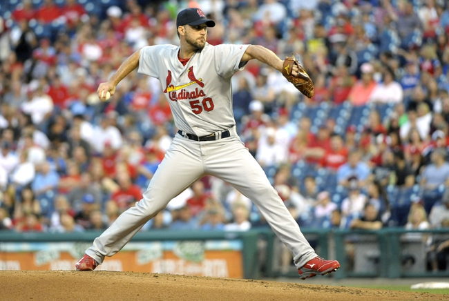 Aug 22, 2014; Philadelphia, PA, USA; St. Louis Cardinals starting pitcher Adam Wainwright (50) throws a pitch during the first inning against the Philadelphia Phillies at Citizens Bank Park. Mandatory Credit: Eric Hartline-USA TODAY Sports