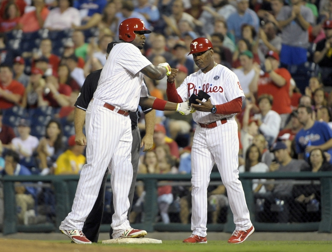 Aug 22, 2014; Philadelphia, PA, USA; Philadelphia Phillies first baseman Ryan Howard (6) gets congratulations from first base coach Juan Samuel (8) after hitting RBI single in the third inning against the St. Louis Cardinals at Citizens Bank Park. Mandatory Credit: Eric Hartline-USA TODAY Sports