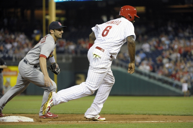 Aug 22, 2014; Philadelphia, PA, USA; Philadelphia Phillies first baseman Ryan Howard (6) races home as St. Louis Cardinals third baseman Matt Carpenter (13) turns to get the ball on throwing error by first baseman Matt Adams (32) (not pictured) during the third inning  at Citizens Bank Park. Mandatory Credit: Eric Hartline-USA TODAY Sports
