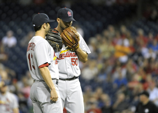 Aug 22, 2014; Philadelphia, PA, USA; St. Louis Cardinals third baseman Matt Carpenter (13) and starting pitcher Adam Wainwright (50) gather on the mound during third inning against the Philadelphia Phillies at Citizens Bank Park. Mandatory Credit: Eric Hartline-USA TODAY Sports