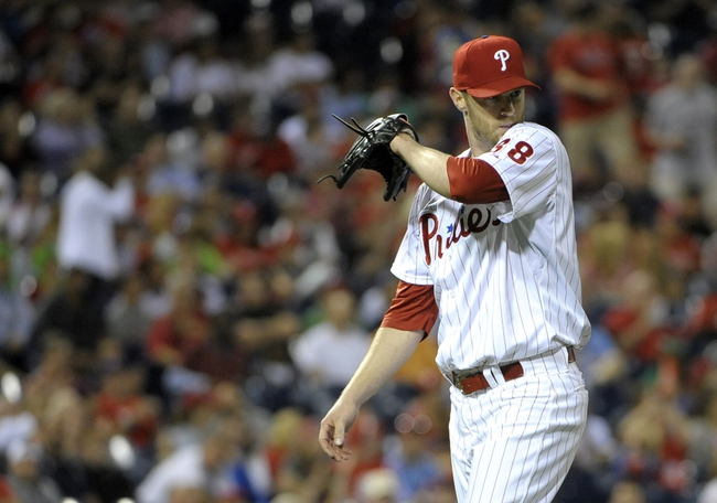 Aug 22, 2014; Philadelphia, PA, USA; Philadelphia Phillies starting pitcher Kyle Kendrick (38) walks off the field in the seventh inning against the St. Louis Cardinals at Citizens Bank Park. The Phillies defeated the Cardinals, 5-4. Mandatory Credit: Eric Hartline-USA TODAY Sports