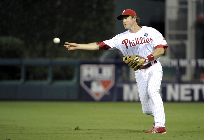 Aug 22, 2014; Philadelphia, PA, USA; Philadelphia Phillies second baseman Chase Utley (26) throws to first base to get a St. Louis Cardinals batter in the eighth inning at Citizens Bank Park. The Phillies defeated the Cardinals, 5-4. Mandatory Credit: Eric Hartline-USA TODAY Sports